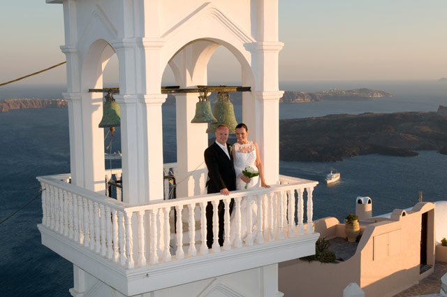 married couple on imerovigli bell tower
